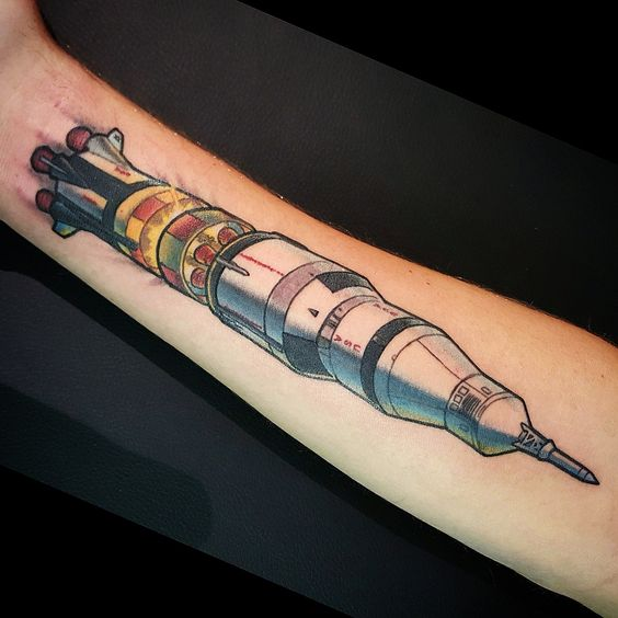 Saturn v rocket tattoo on the forearm