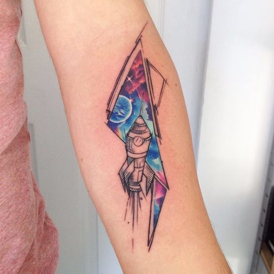 Spaceship tattoo with a cosmic background