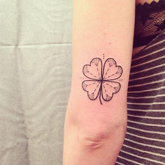 Stylized clover tattoo