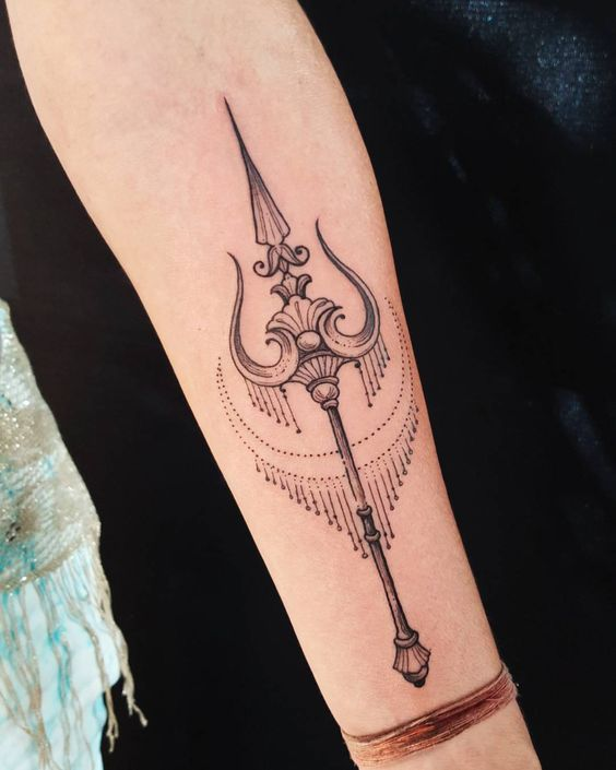 Stylized trident tattoo on the forearm