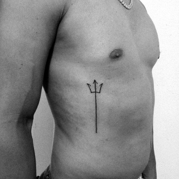 Thin black trident tattoo on the rib cage