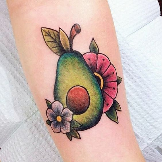 Traditional avocado and flowers tattoo