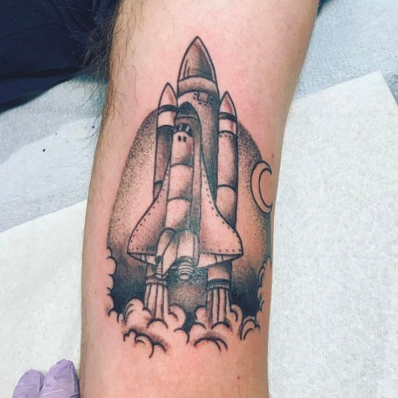 Traditional blackwork tattoo of a space shuttle launch