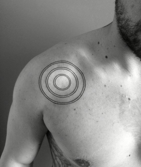 Triple circle tattoo on the right shoulder