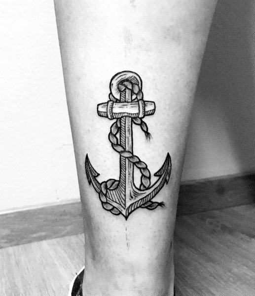 Woodcut anchor with a rope on the left calf