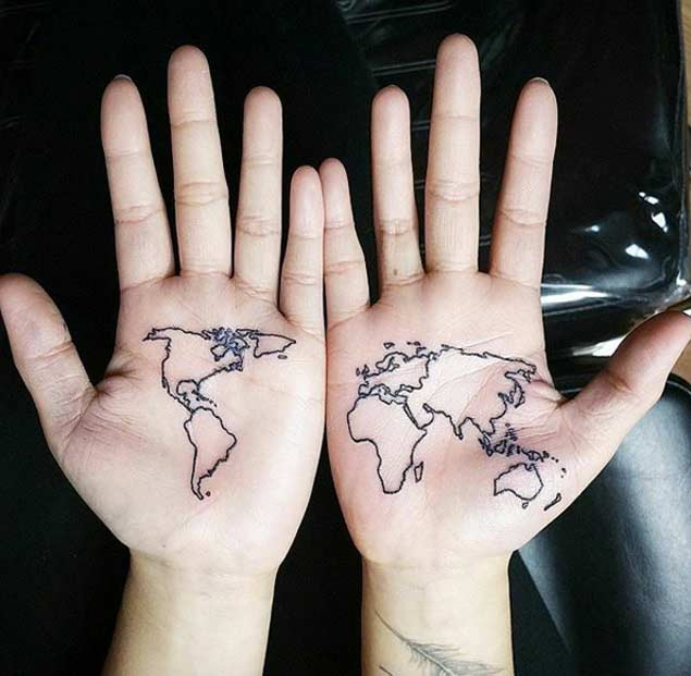 Black world map tattoo on both palms