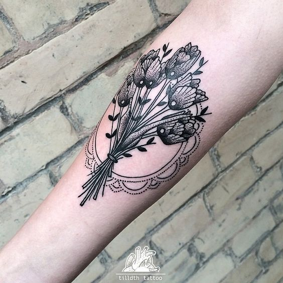 Blackwork tulip bundle tattoo