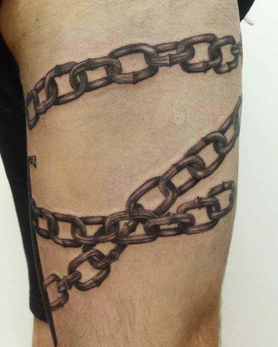 Chain tattoo wrapped around the left leg