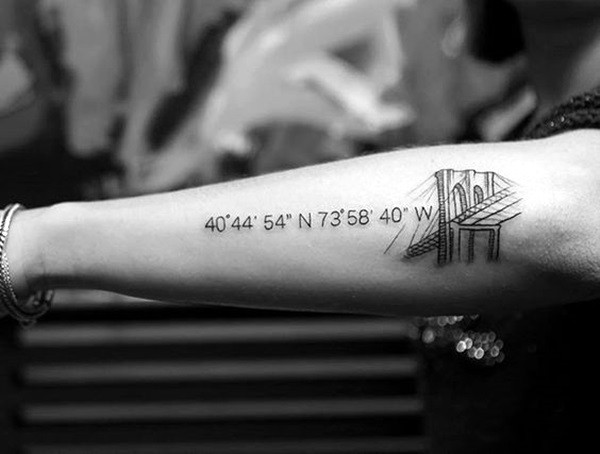 Coordinates tattoo with a bridge