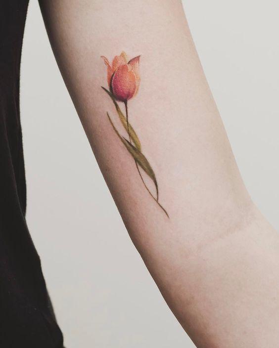 Delicate orange tulip tattoo