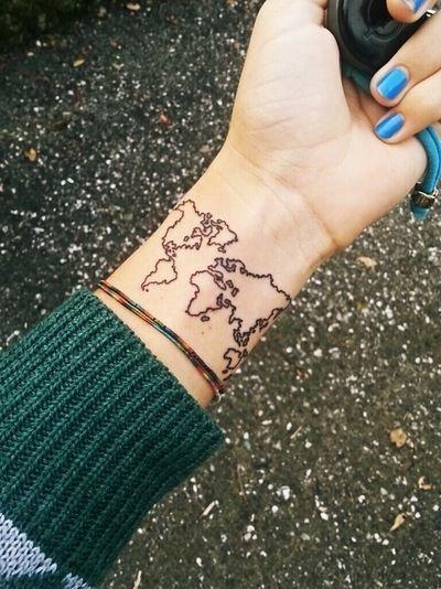 Delicate world map on the left inner wrist