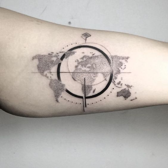 Dot work world map and compass tattoo