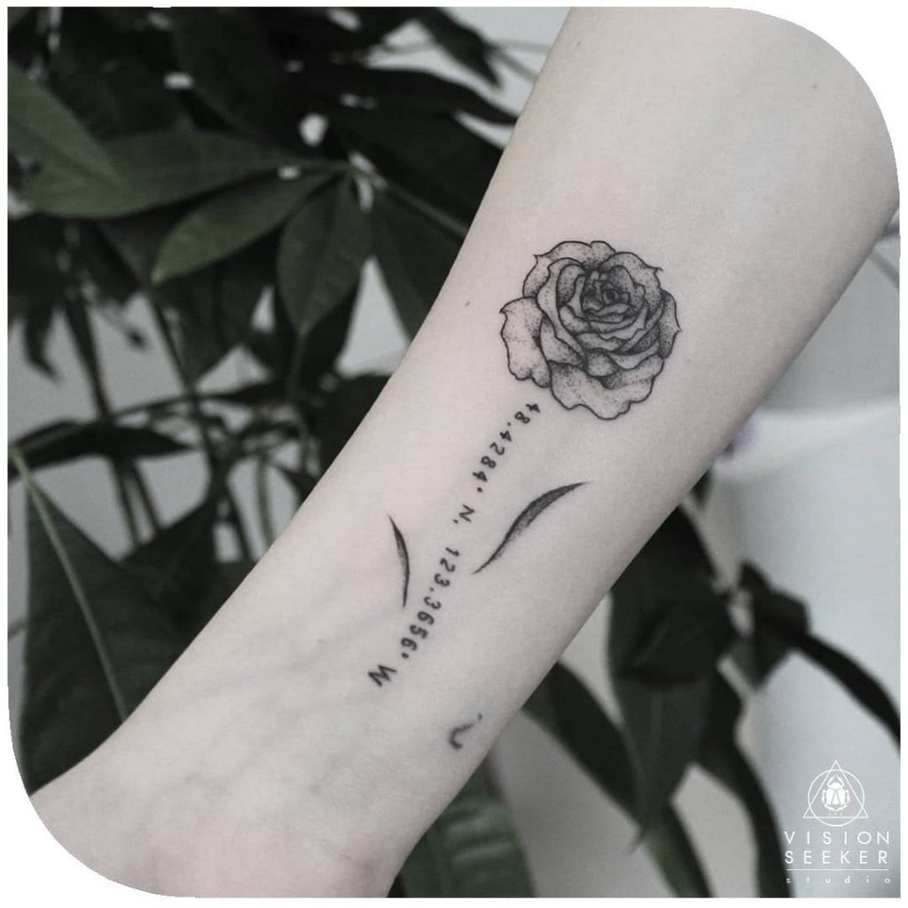 Gorgeous black coordinates and rose tattoo on the inner forearm