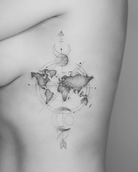 Hand poked world map arrow and crescent moon tattoo