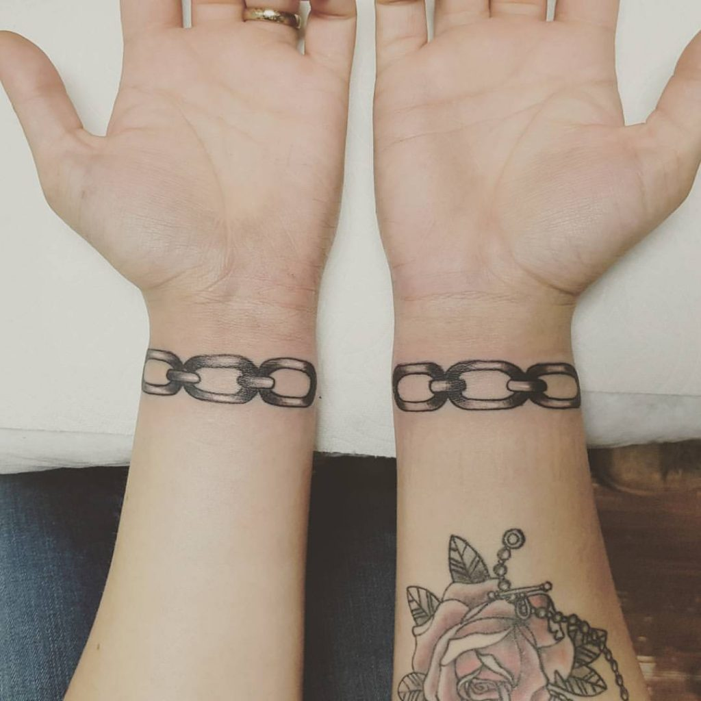 Matching chain tattoos on wrists