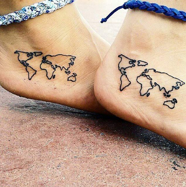 Matching world map tattoos on ankles