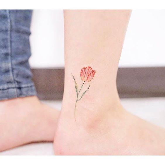 Orange tulip tattoo on the ankle