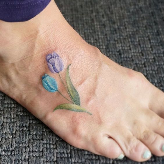 Purple and blue tulip on the right foot