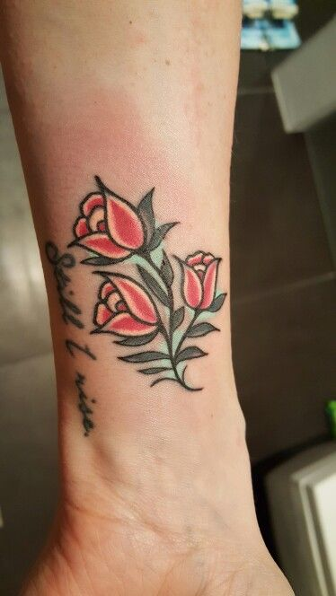Traditional style red tulips tattoo