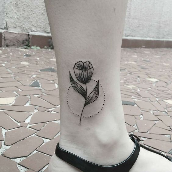 Tulip and dotted circle tattoo on the ankle