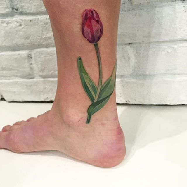 Watercolor pink tulip tattoo on the calf