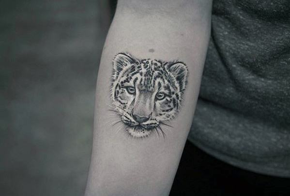 Amazing snow leopard face tattoo
