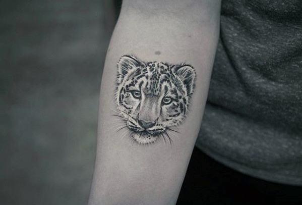 Amazing snow leopard face tattoo