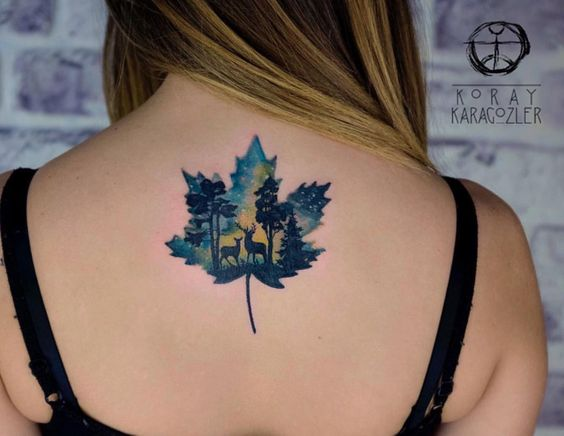 Double exposure maple leaf and forest scenery tattoo