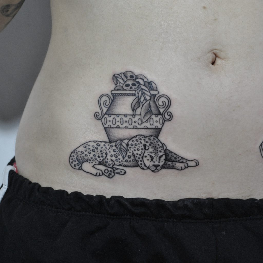 Laying leopard tattoo on the belly