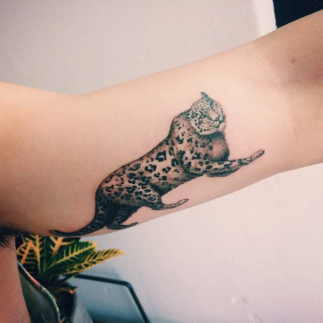 Leopard tattoo on the left inner arm