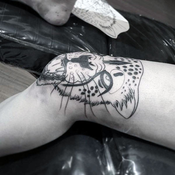 Leopard knee tattoo