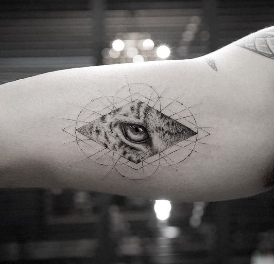Leopard's eye tattoo