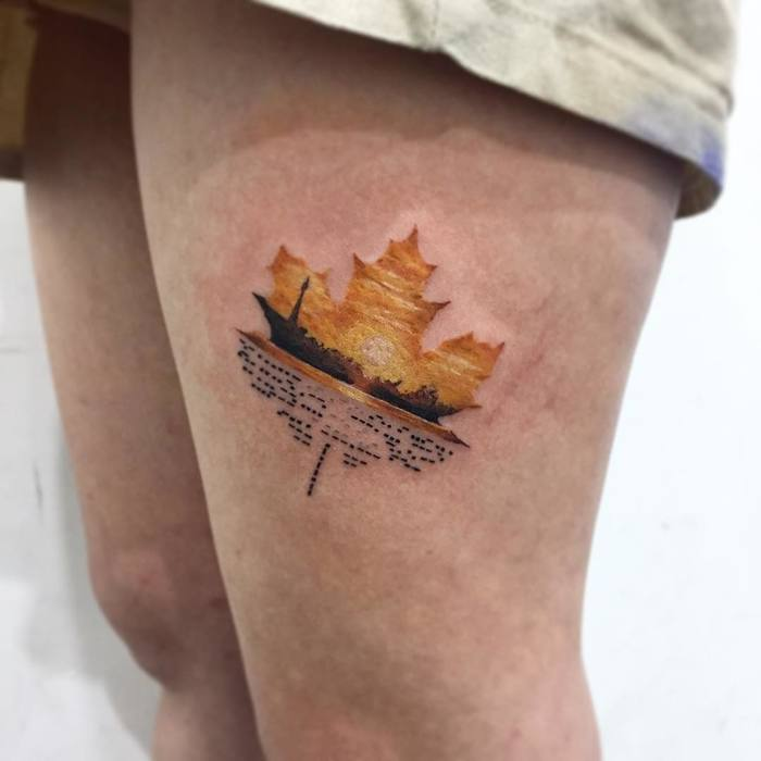 Maple leaf sunset tattoo