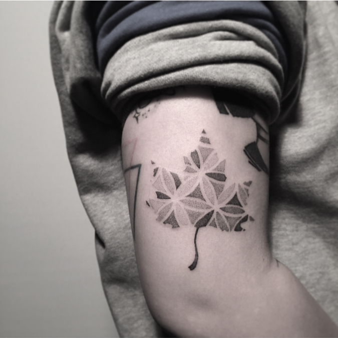 Maple leaf with flower of life pattern tattoo