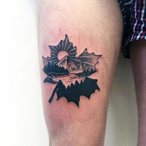 Mountainous landscape on a maple leaf