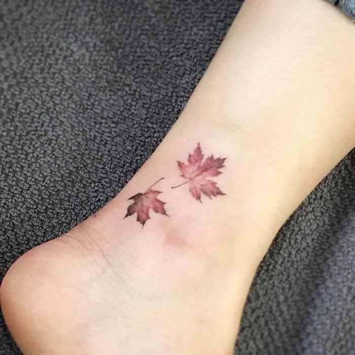 Two small brown maple leaves on the ankle