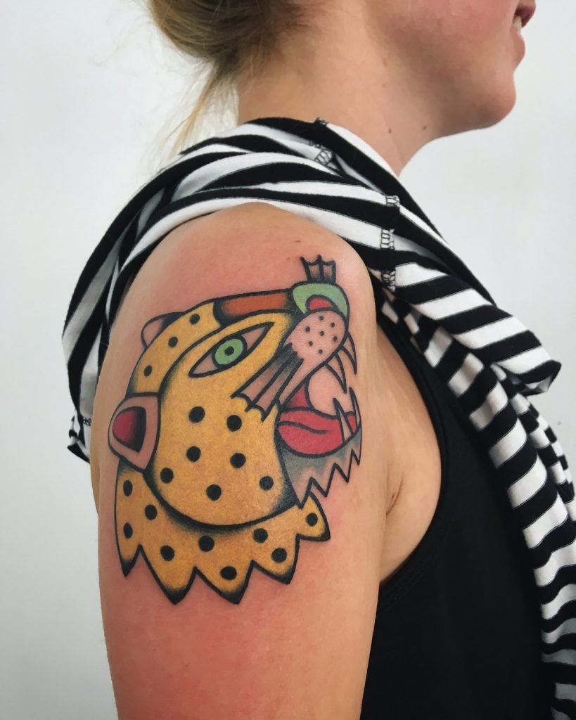 Yellow leopard tattoo on the arm