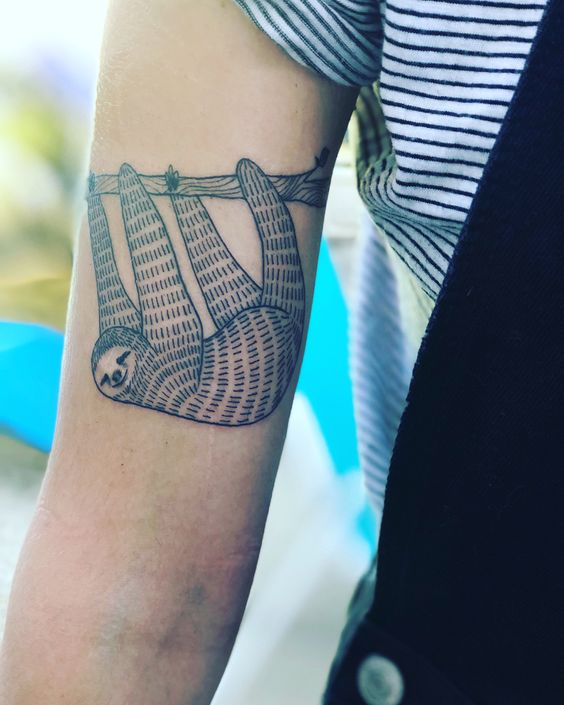 Adorable sloth tattoo on the right arm