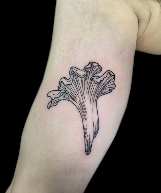 Chanterelle mushroom tattoo on the arm