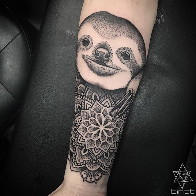 Dot work style sloth and mandala tattoo