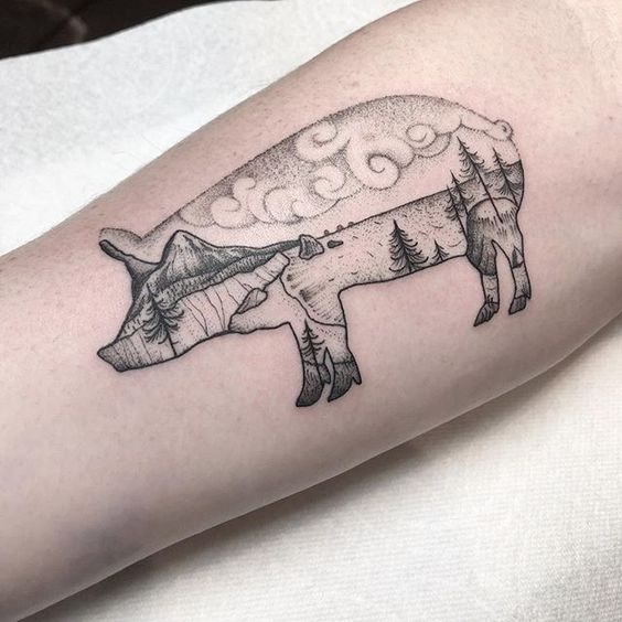 Double exposure pig and landscape tattoo