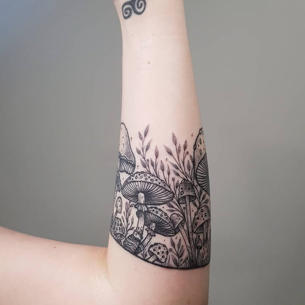 Gorgeous mushroom armband tattoo by Brie Dots