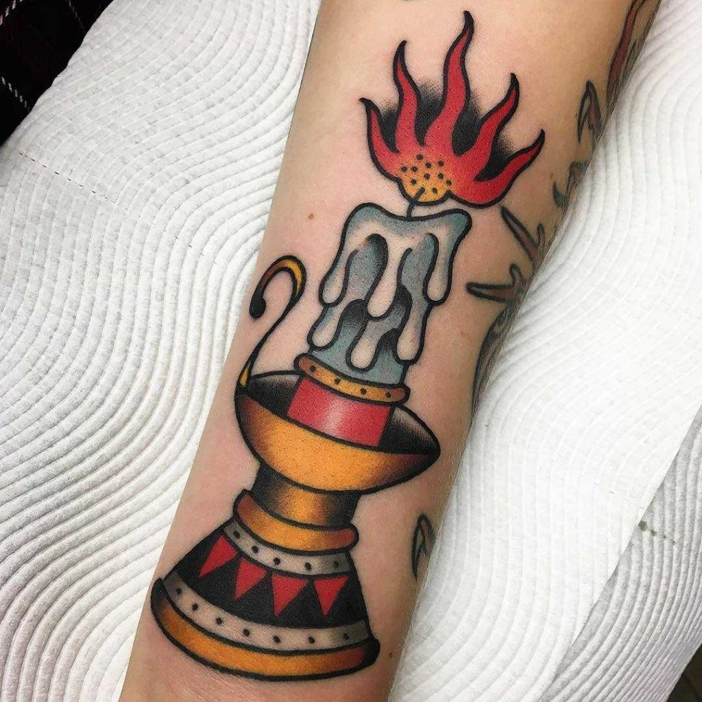 Old-school candle tattoo by Jacob Cross