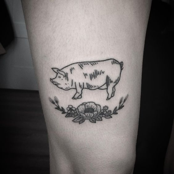 Pig and flowers tattoo