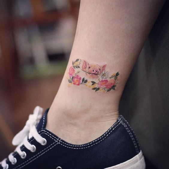 Pig in the flowers tattoo