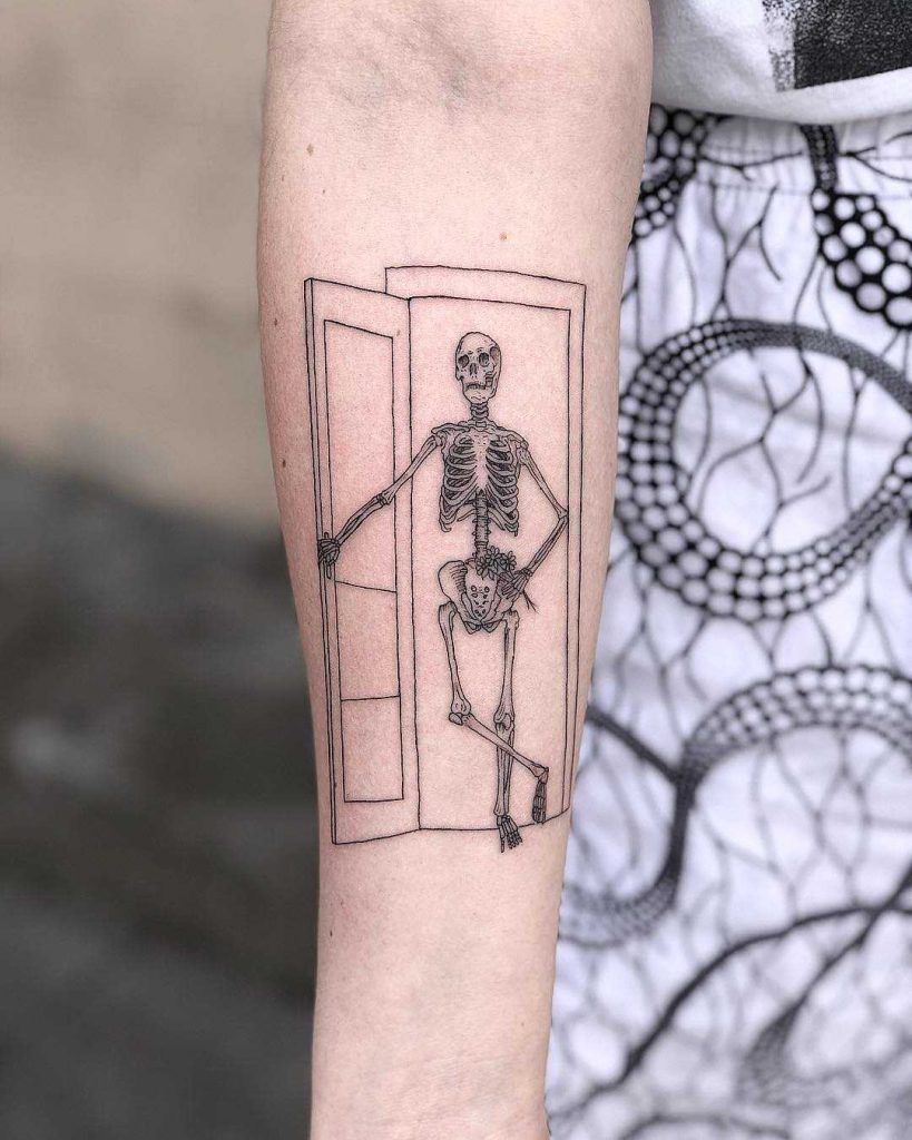 Skeleton in a doorway by Johnson Luong