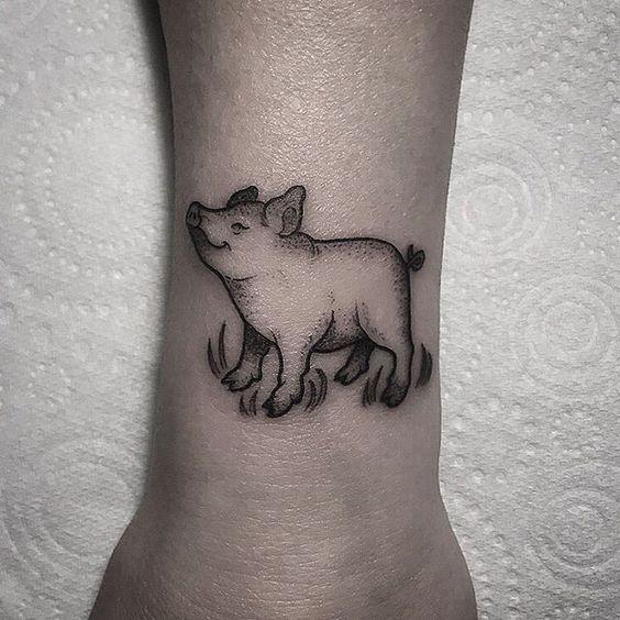 Small cute pig tattoo on the wrist