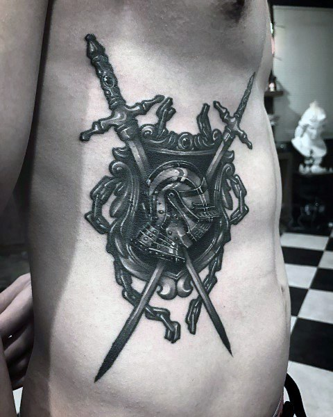 Swords, shield and helmet tattoo