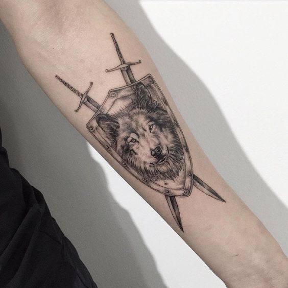 Wolf shield and swords tattoo by tattooist intat