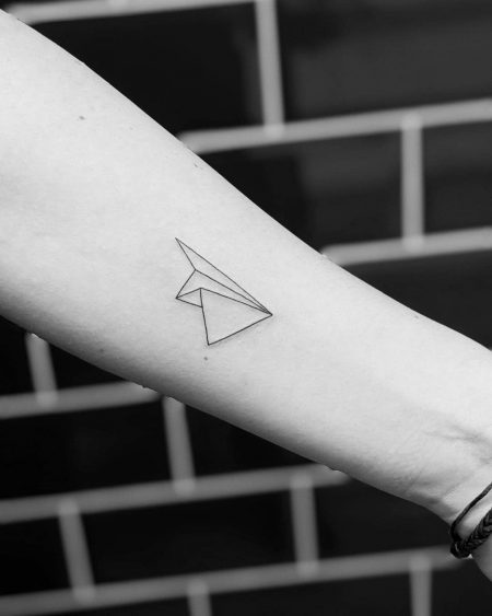 Paper airplane tattoo – the symbol of freedom and childhood